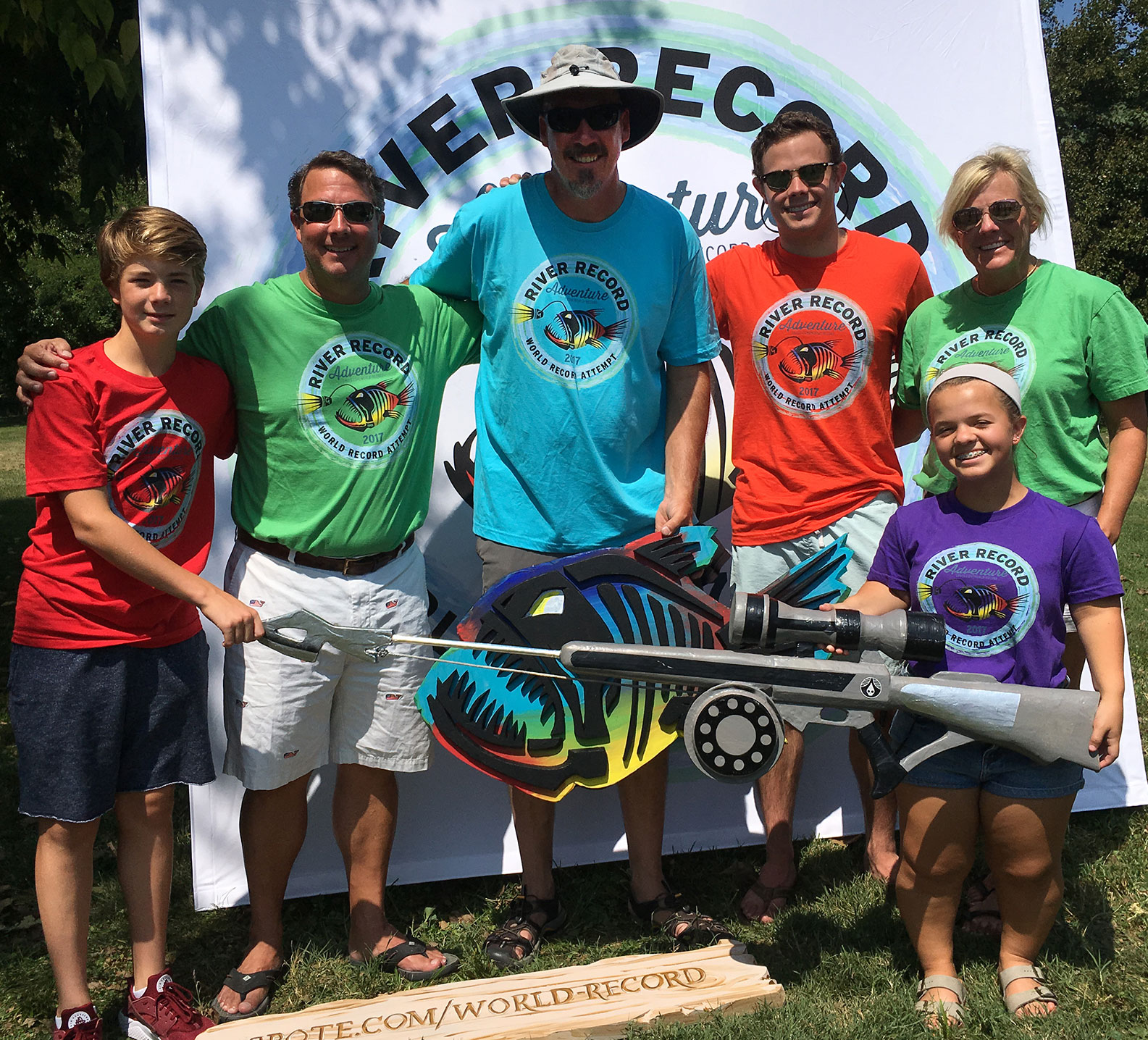 Marc Phelps with the Grote family during the River Record Adventure kickoff party in Madison, Indiana