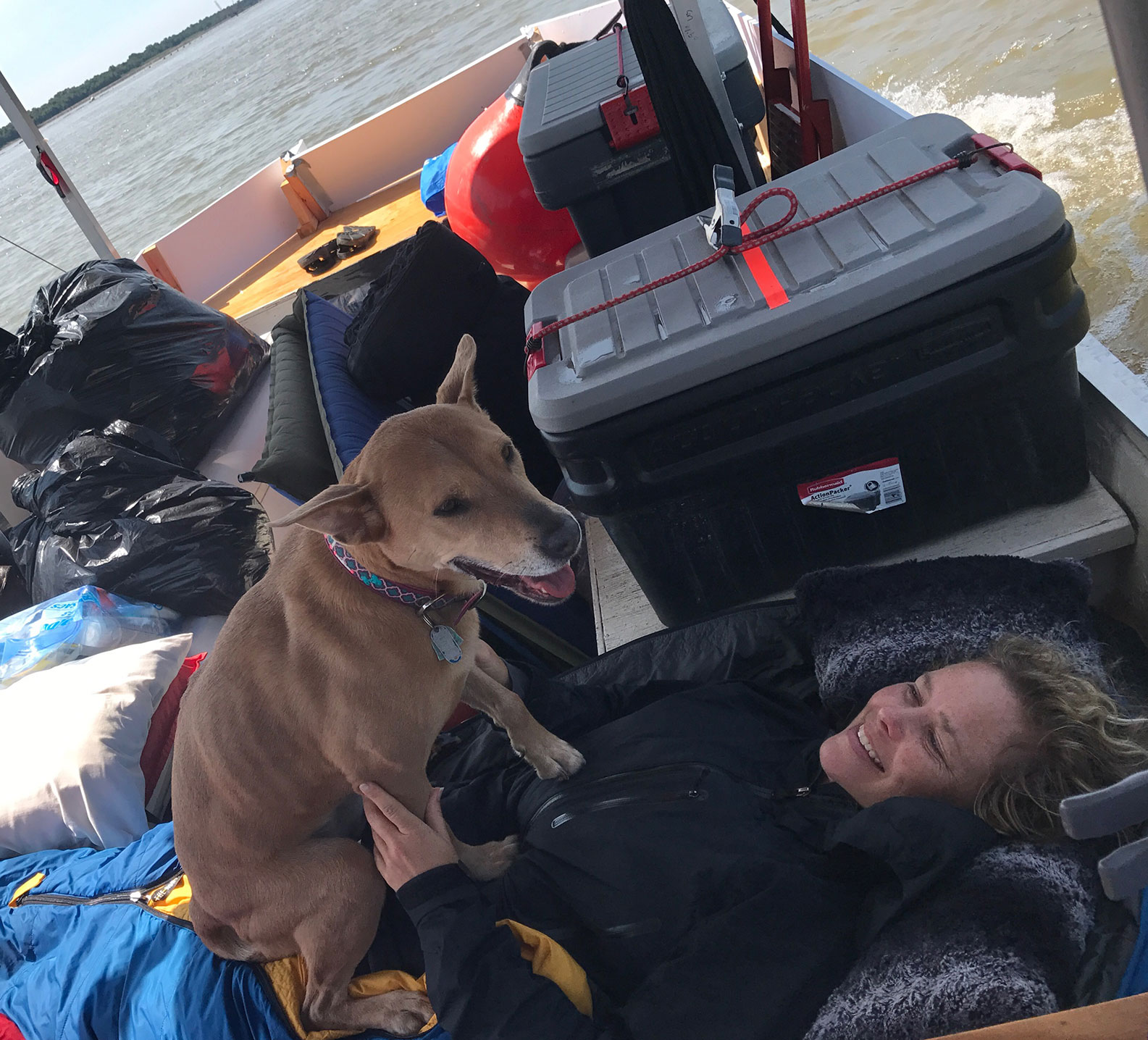 Cheryl and her dog Tula on the river record adventure jon boat day 8