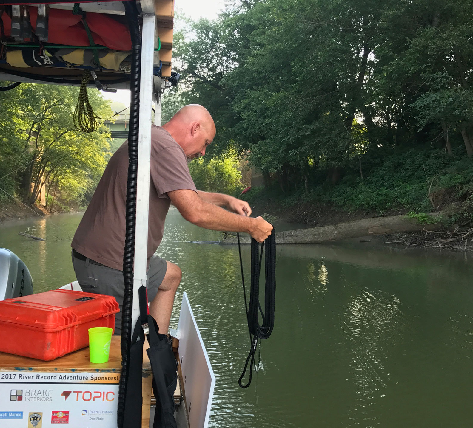 Marc Phelps sorting his boat lines over the water