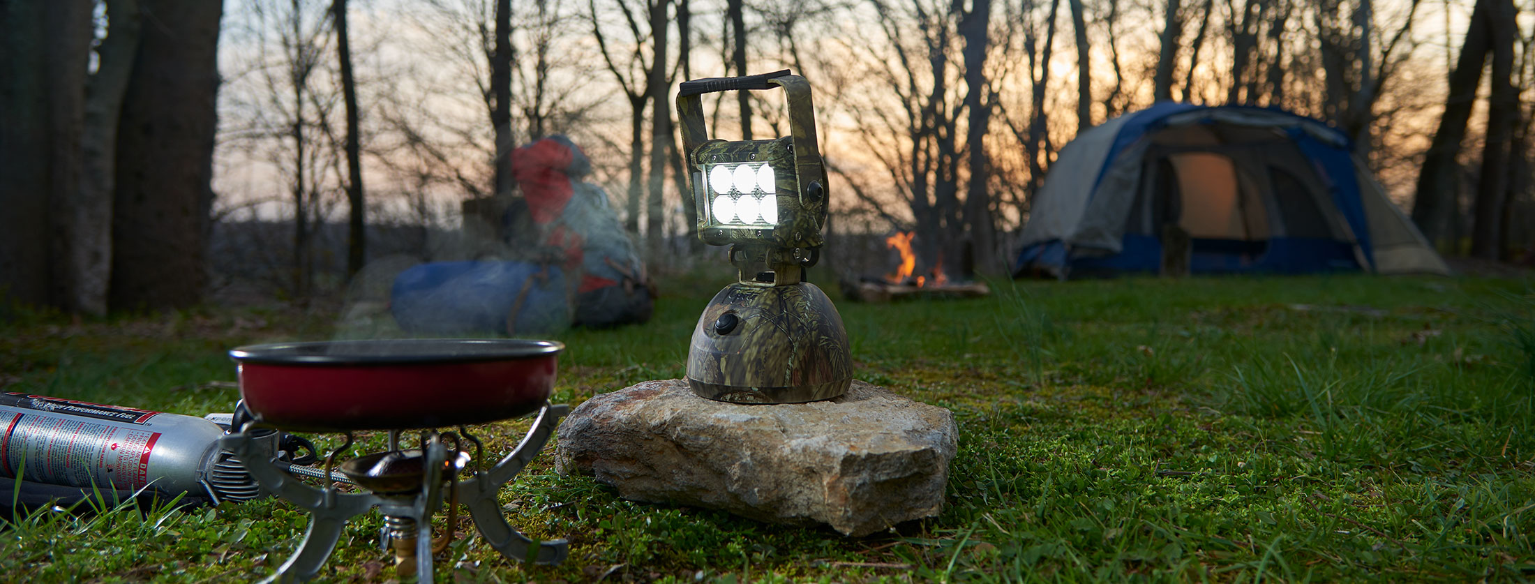 Camo LED Light being used at campsite by the campfire