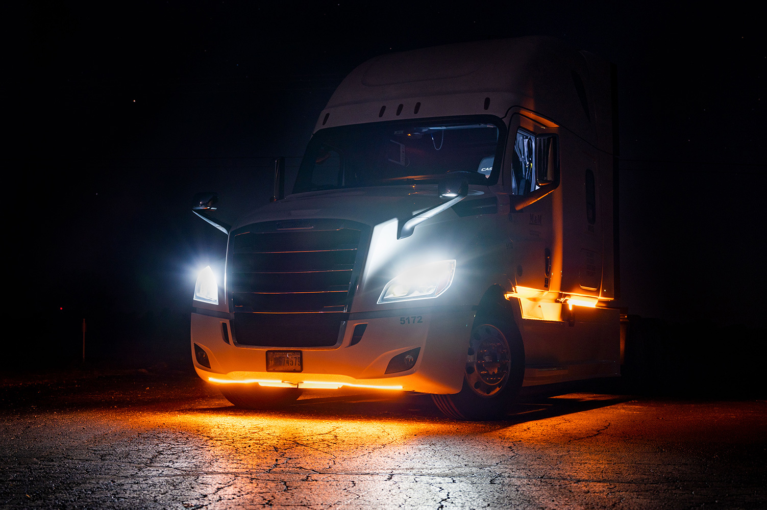 Semi truck with amber underglow
