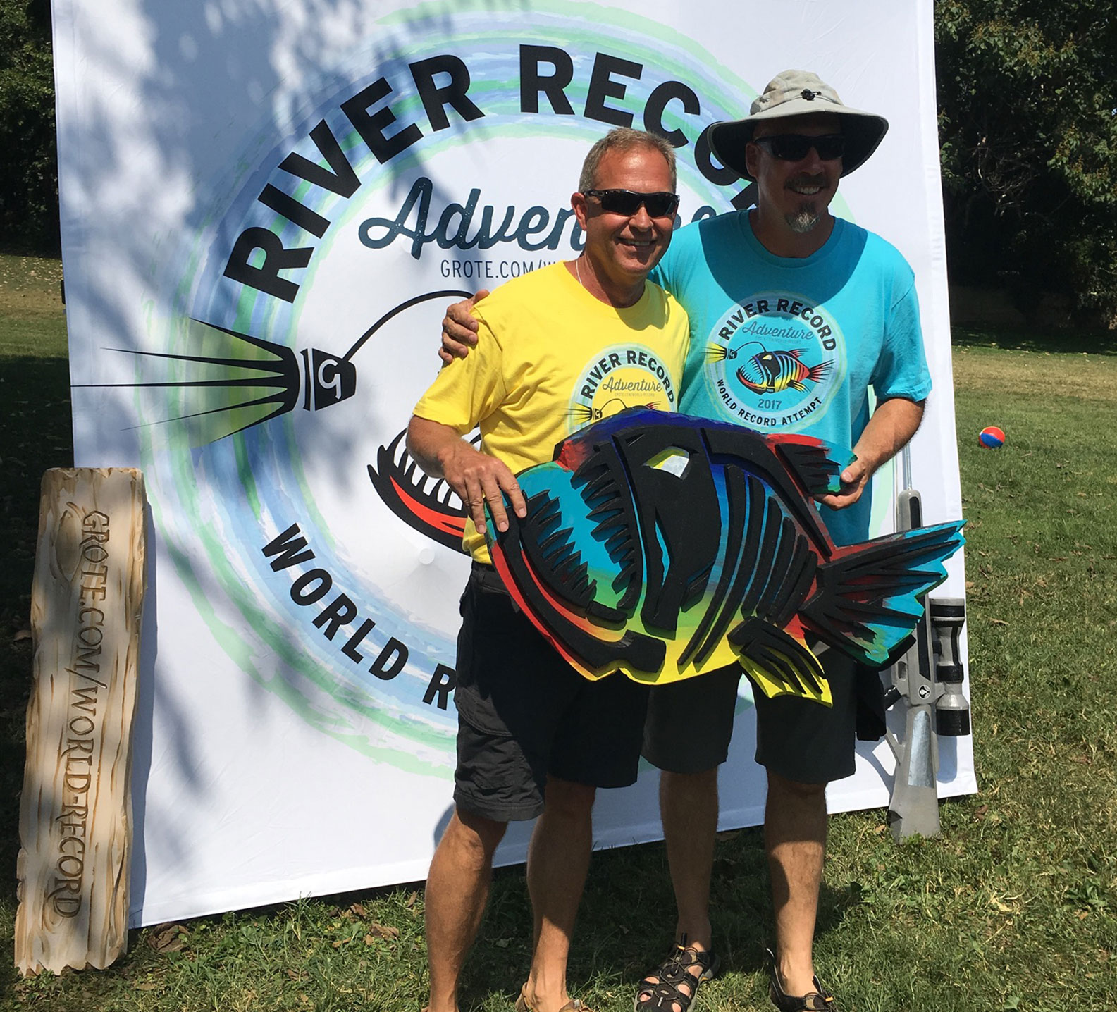 Marc Phelps poses for a photo with an old friend during the River Record Adventure Kickoff party in Madison