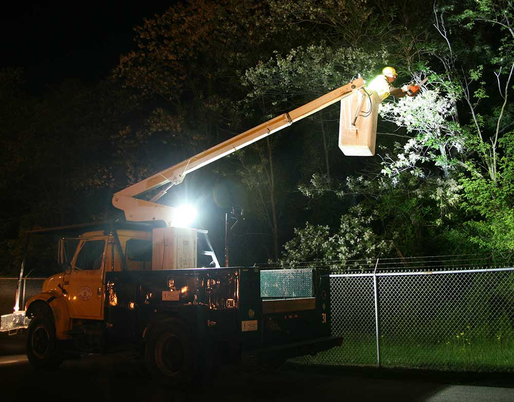Grote LED lights on bucket truck at night