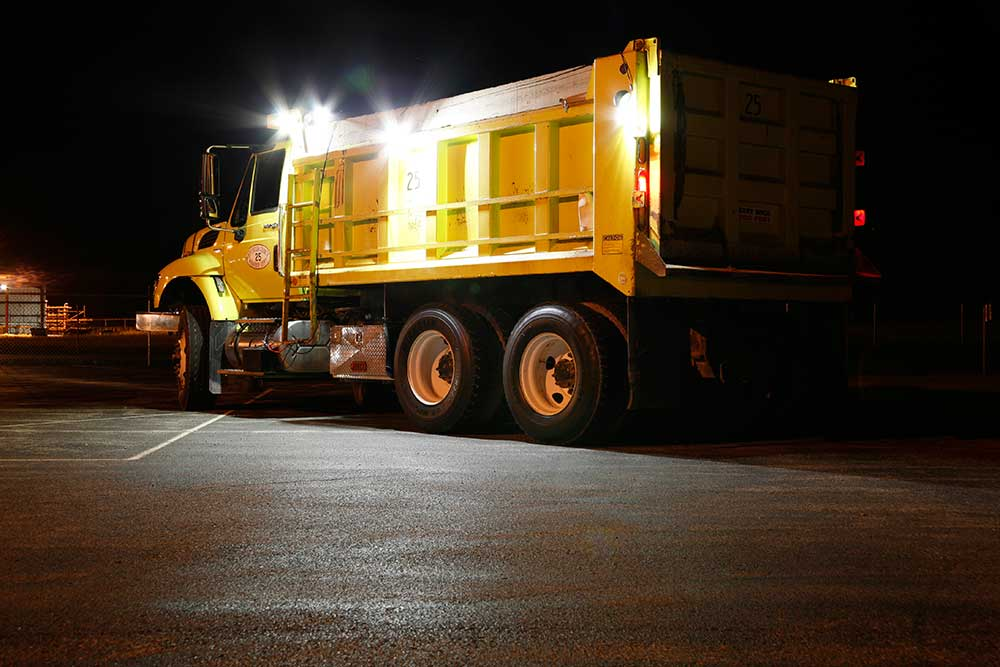 Grote LED lights on dump truck at night