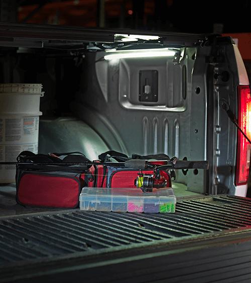 LED light strip in truck bed illuminating night fishing gear